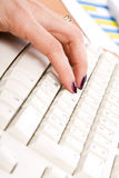 Hand typing in a keyboard Stock Photography