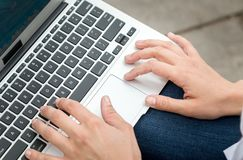 Hand typing on keyboard Stock Images