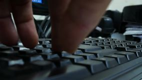 Hand typing on keyboard. Close up Hand typing on keyboard stock footage