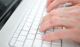 Hand typing on a keyboard Royalty Free Stock Images