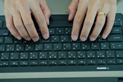 Hand typing keyboard labtop Royalty Free Stock Photography