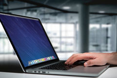 Hand typing on a keyboard of laptop with operating system screen Stock Photography