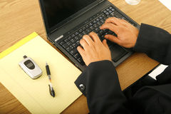Hand Typing On Laptop. Close up shot of male hand typing on laptop. laptop screen is blank stock photo