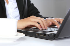 Hand typing on laptop Royalty Free Stock Image