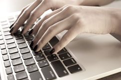 Hand typing on laptop keyboard Stock Photography
