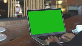 Hand typing on laptop keyboard showing green screen, 4k. Hand typing on laptop keyboard showing green screen stock video footage