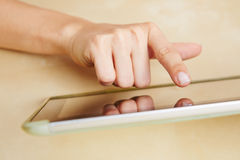 Hand typing on tablet computer Royalty Free Stock Photography
