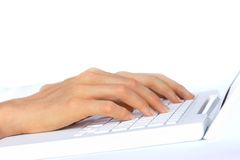 Hand Typing on White Laptop Royalty Free Stock Photography