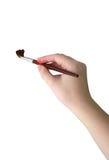 Hand u. Malerpinsel lizenzfreies stockbild