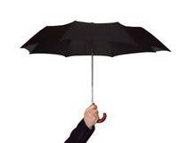 Hand with umbrella Stock Photos