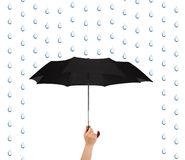 Hand with umbrella and rain Stock Photography