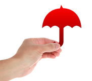 Hand With Umbrella. Hand with red umbrella on white stock photography