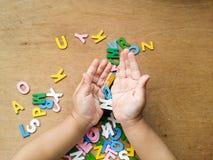 Hand und Alphabete Stockbild