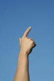 Hand und blauer Himmel Stockbilder