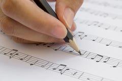 Hand und Bleistift Lizenzfreies Stockfoto
