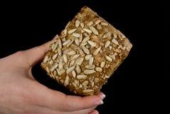Hand und Brot Lizenzfreie Stockfotografie