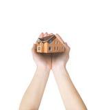 Hand und das Haus Stockfotografie