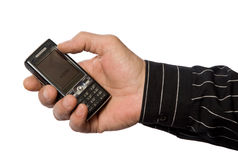 Hand und das Telefon Stockfotos