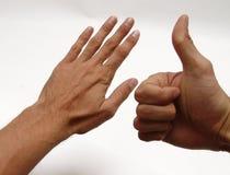 Hand und Daumen Stockfotos