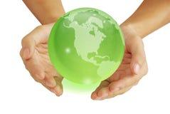 Hand und die Erde Lizenzfreies Stockbild