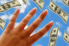 Hand und Dollar Stockfotos