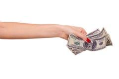 Hand und Dollar der Frau. Lizenzfreie Stockfotografie