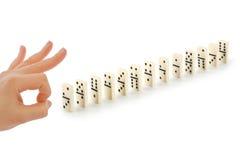 Hand und Domino Stockfotografie