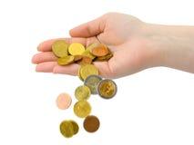 Hand und fallende Münzen Lizenzfreie Stockfotos