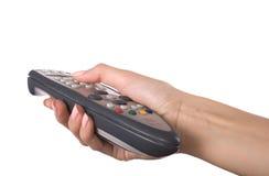 Hand und Fernsehkonsole Lizenzfreie Stockfotografie