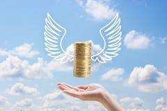 Hand- und Fliegenmünzen Lizenzfreie Stockbilder