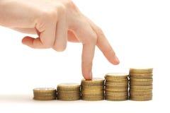 Hand- und Geldtreppenhaus getrennt auf Weiß Lizenzfreies Stockfoto