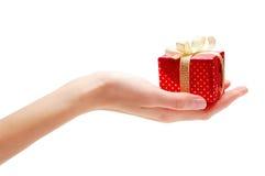 Hand und Geschenk Stockbild