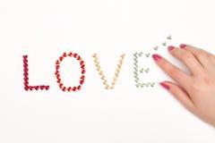 Hand und Liebe Stockfotos