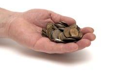 Hand und Münzen Lizenzfreie Stockfotos