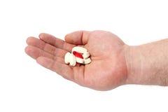 Hand und Pille. Stockbild