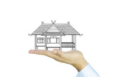Hand und süßes Haus Stockbilder
