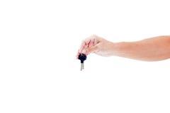 Hand und Schlüssel lokalisiert auf weißem Hintergrund Stockbilder