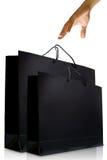 Hand- und Schwarzglasurpapier-Einkaufstasche Lizenzfreie Stockfotos