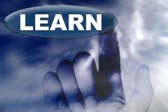Hand und Taste mit Wort von ERLERNEN Lizenzfreie Stockbilder