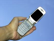Hand und Telefon stockbild