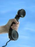 Hand und Telefon Stockfoto