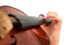 Hand und Violine Stockfotos