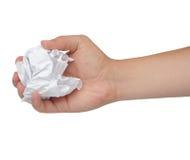 Hand und zerknittertes Papier lokalisiert auf Weiß Lizenzfreie Stockbilder