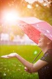 Hand from under the umbrella rain Royalty Free Stock Photo