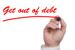 Hand underlining the words get out of debt Stock Image
