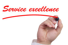 Hand underlining the words service excellence in red stock photo