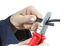 Hand with universal pliers. Stock Images