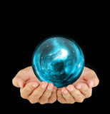 Hand and the universe. Flat Hand With Blue Glowing Crystal ball-The universe Royalty Free Stock Images