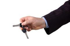 Hand with unlocking key Stock Photos