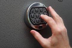 Hand unlocking Modern digital lock on safe royalty free stock photography